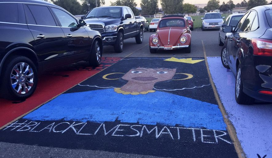 "This Monday, Sept. 19, 2016 photo provided by kboi2.com shows a mural that school administrators at Mountain Home High School In southern Idaho say has to be removed because its placement in a school parking lot violates school policy. About 100 students have started a protest amid concerns the ""Black Lives Matter"" message of the art is the real reason officials want it gone. (kboi2.com via AP)"