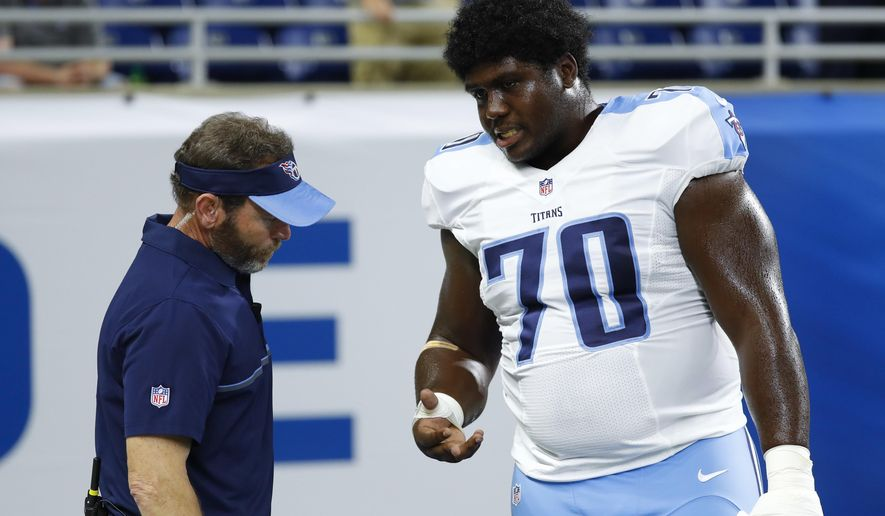 FILE - In this Sunday, Sept. 18, 2016, file photo, Tennessee Titans guard Chance Warmack (70) has his hand checked by a trainer before an NFL football game against the Detroit Lions in Detroit. Warmack will have surgery to repair a torn tendon in a finger on his right hand, and the Titans plan to place him on injured reserve, coach Mike Mularkey said Wednesday, Sept. 21, 2016.  (AP Photo/Paul Sancya, File)