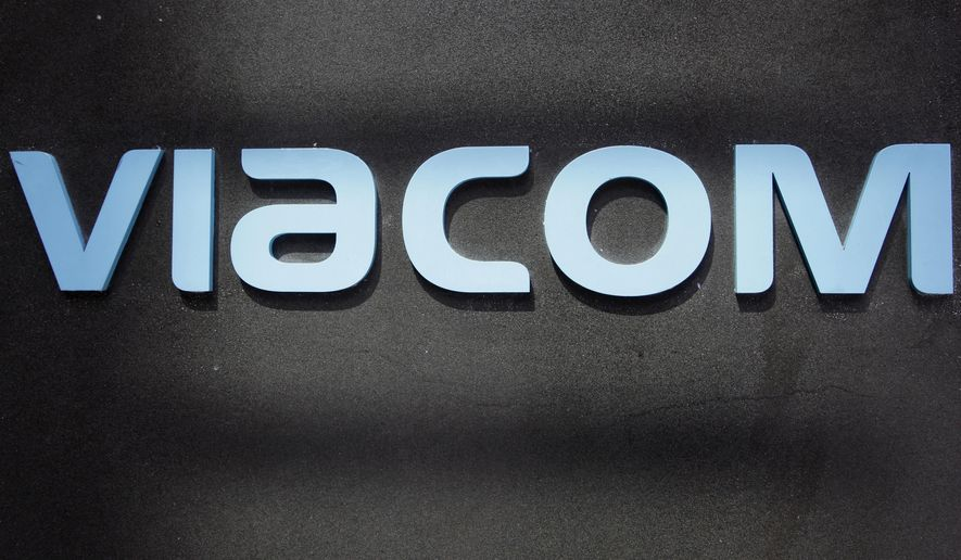 FILE - This Aug. 3, 2011, file photo, shows the Viacom logo at Viacom headquarters in New York. Viacom said Wednesday, Sept. 21, 2016, that interim CEO Tom Dooley will leave Nov. 15 and the company is cutting its dividend in half in the first major moves from the company since longtime CEO Philippe Dauman left in August. (AP Photo/Mark Lennihan, File)