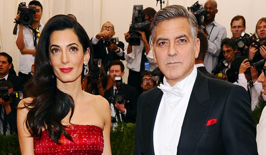 "Amal Clooney, left, and George Clooney arrive at The Metropolitan Museum of Art's Costume Institute benefit gala celebrating ""China: Through the Looking Glass"" on Monday, May 4, 2015, in New York. (Photo by Charles Sykes/Invision/AP)"