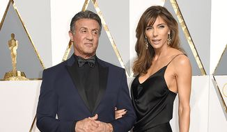Sylvester Stallone and wife Jennifer Flavin. (AP Photo)  ** FILE **