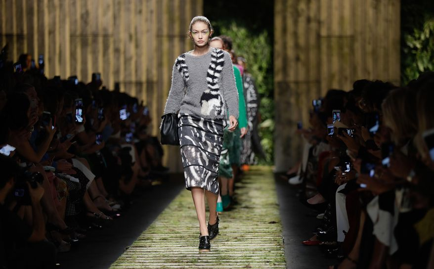 Model Gigi Hadid wears a creation part of the Max Mara women's Spring-Summer 2017 collection, that was presented in Milan, Italy, Thursday, Sept. 22, 2016. (AP Photo/Luca Bruno)