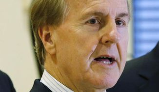 """In this Monday Jan. 18, 2016 file photo, U.S. Rep. Robert Pittenger, speaks to the media at the Landstuhl Regional Medical Center in Landstuhl, Germany. Pittenger, a Republican congressman who represents the Charlotte area said Thursday that people are protesting in the city because they """"hate white people.""""  (AP Photo/Michael Probst, File)"""