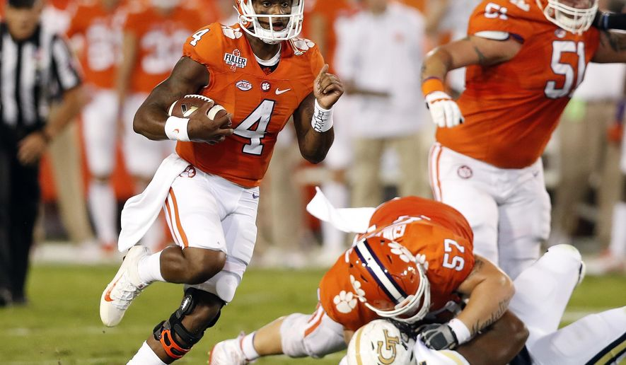 Clemson quarterback Deshaun Watson (4) breaks into the open field as offensive lineman Jay Guillermo (57) blocks Georgia Tech defensive lineman Kyle Cerge-Henderson (54) in the first half of an NCAA college football game Thursday, Sept. 22, 2016, in Atlanta. (AP Photo/John Bazemore)