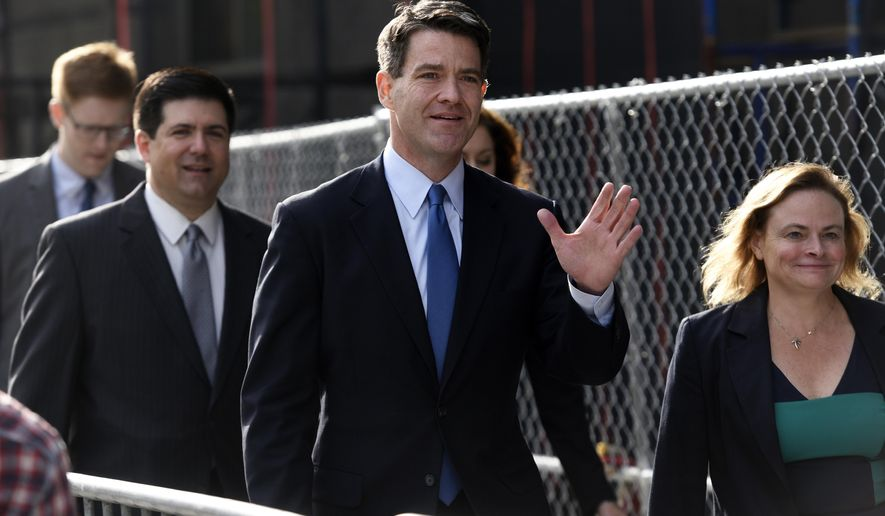 CORRECTS SPELLING OF BARONI - Bill Baroni, center, and his attorney Michael Baldassare, far left, arrive at the Martin Luther King Jr. Federal Courthouse in Newark  N.J., Wednesday, Sept. 21, 2016. Baroni and Bridget Ann Kelly Baroni are charged with causing traffic jams near the George Washington Bridge in September 2013. Baroni was an executive at the Port Authority of New York and New Jersey. Kelly was Christie's deputy chief of staff.   (Danielle Parhizkaran/Northjersey.com via AP)