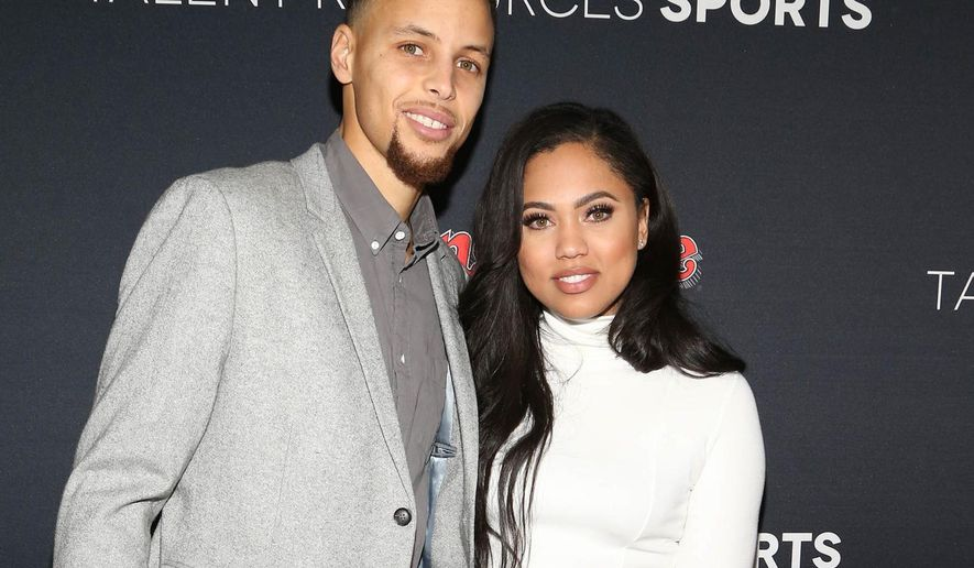 "FILE - In this Feb. 6, 2016 file photo, NBA basketball player Stephen Curry, left, and his wife Ayesha Curry arrive at the Super Bowl 50 Rolling Stone Party in San Francisco. Ayesha Curry launched her first cookbook, ""The Seasoned Life: Food, Family, Faith, and the Joy of Eating Well."" (Photo by Omar Vega/Invision/AP, File)"