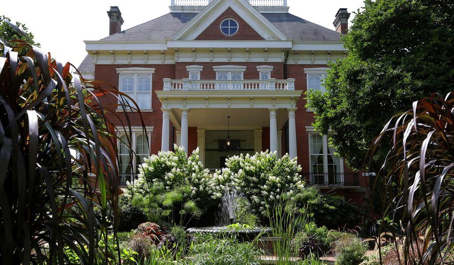 File - In this Aug. 28, 2014, file photo, landscaping is maintained at the Illinois Executive Mansion in Springfield, Ill. An agreement shows that a privately funded renovation of the Illinois Executive Mansion in Springfield will follow wage and bidding rules required of traditional taxpayer-funded construction projects. (AP Photo/Seth Perlman, File)