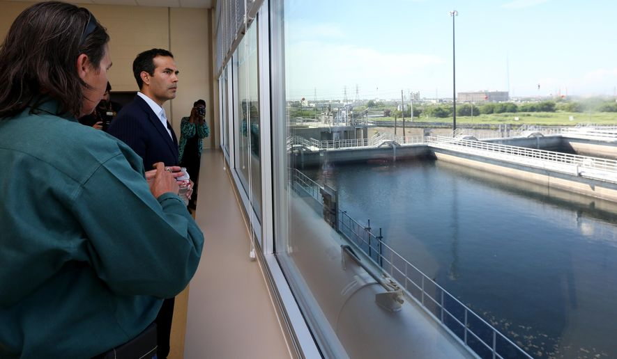 Cynthia Diaz, superintendent for the wastewater treatment plant in Galveston, gives Texas Land Commissioner George P. Bush a tour of the facility Wednesday, Sept. 21, 2016, following the dedication and ribbon cutting ceremony. Officials dedicated an $85 million wastewater treatment plant in Galveston as the largest Hurricane Ike recovery project since the storm hit in 2008. (Jennifer Reynolds/The Galveston County Daily News via AP)