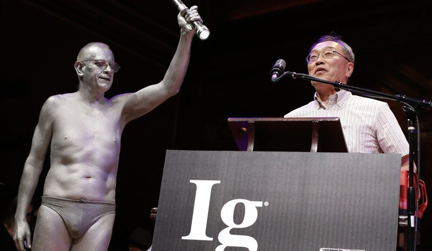 Atsuki Higashiyama, from Ritsumeikan University in Japan, speaks after receiving the Ig Nobel Perception Prize during ceremonies at Harvard University in Cambridge, Mass., Thursday, Sept. 22, 2016. Higashiyama was awarded the prize for investigating whether things look different when you bend over and view them between your legs. (AP Photo/Michael Dwyer)