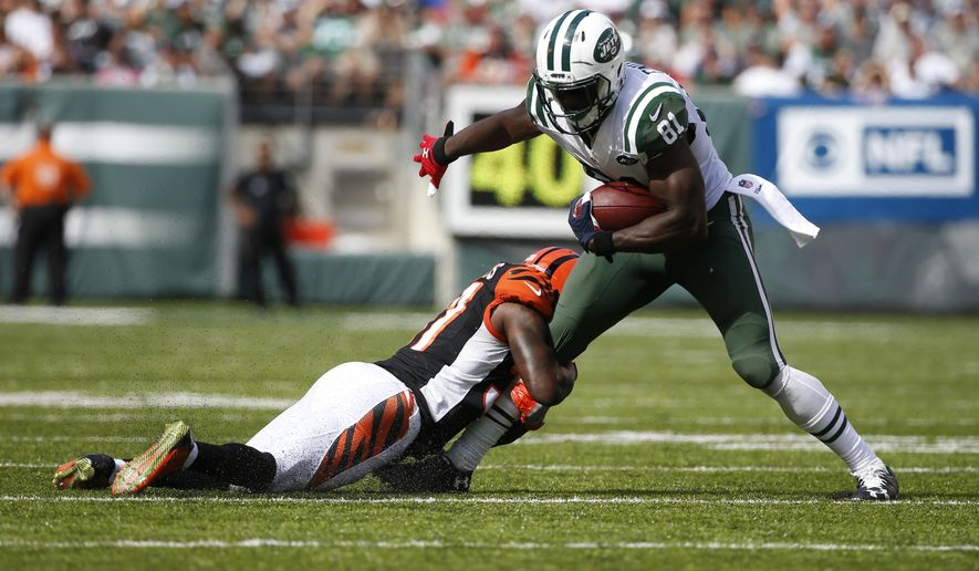 FILE - In this Sunday, Sept. 11, 2016, file photo, Cincinnati Bengals' Chris Lewis-Harris (37) tackles New York Jets' Quincy Enunwa (81) during the second half of an NFL football game in East Rutherford, N.J. Through two games, Enunwa is leading the Jets with 13 catches for 146 yards and a touchdown. And that's for a team that also has wide receivers Brandon Marshall and Eric Decker, and running back Matt Forte in the mix. (AP Photo/Kathy Willens, File)
