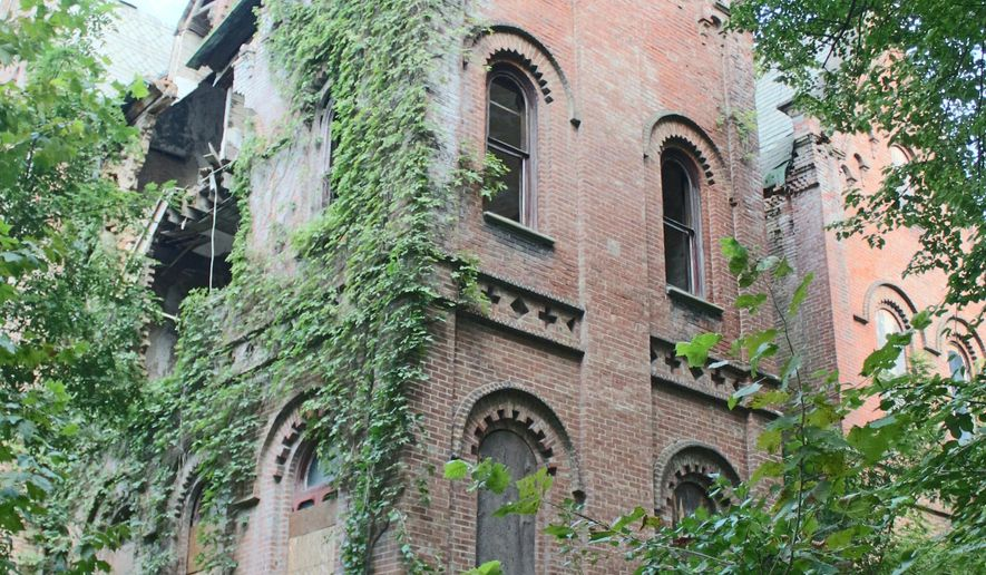 "This photo provided by Maltz Auctions shows Wyndclyffe Castle in Rhinebeck, N.Y. The dilapidated mansion in upstate New York believed to have inspired the phrase ""Keeping up with the Joneses"" is on the auction block. The mansion was built in 1853 in Rhinebeck as the country house of Manhattan socialite Elizabeth Schermerhorn Jones, a member of a wealthy family and aunt of American novelist Edith Wharton. The property's elegance is said to have prompted owners of nearby Hudson Valley estates to build even bigger mansions, giving birth to the idiom ""Keeping up with the Joneses."" (Maltz Auctions via AP)"