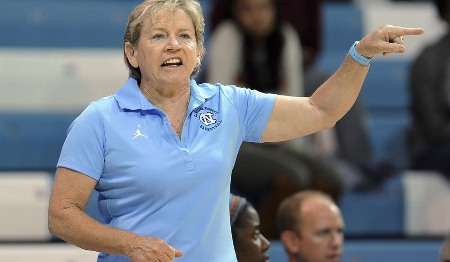 FILE - In this Nov. 4, 2015, file photo, North Carolina coach Sylvia Hatchell reacts to a call during her team's exhibition college basketball game against Wingate in Chapel Hill, NC. UNC announced a two-year extension through the 2019-20 season for Hatchell on Thursday along with new contracts or extensions for six other Tar Heels head coaches.(Christine T. Nguyen/The Herald-Sun via AP, File)