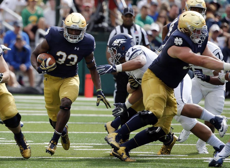 FILE - In this Saturday, Sept. 10, 2016, file photo, Notre Dame running back Josh Adams (33) carries the ball during the first half of an NCAA college football game against Nevada in South Bend, Ind. Adams has tried to help set the tone for the Fighting Irish coming off a disappointing loss to Michigan State that knocked them out of the playoff race early. (AP Photo/Charles Rex Arbogast, File)