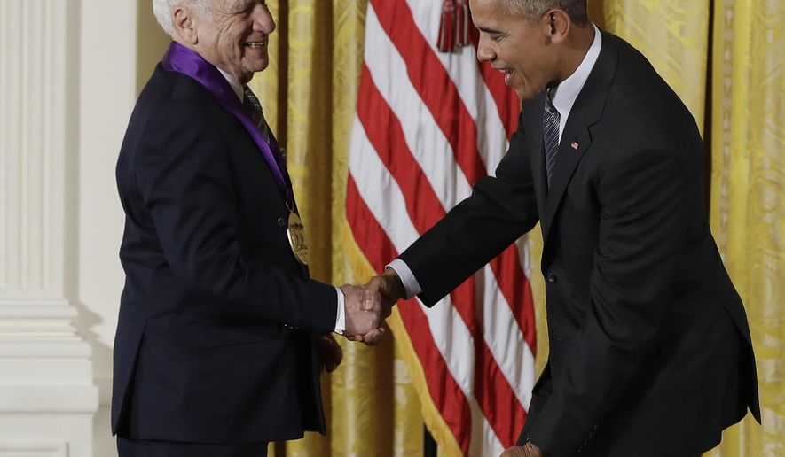 President Barack Obama jokes with actor, comedian and writer, Mel Brooks, as he awards him the 2015 National Medal of Arts during a ceremony in the East Room of the White House, Thursday, Sept. 22, 2016, in Washington. (AP Photo/Carolyn Kaster)