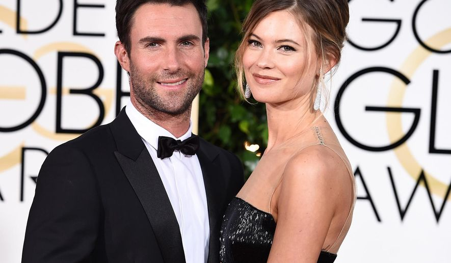 """FILE - In this Jan. 11, 2015 file photo, Adam Levine, left, and Behati Prinsloo arrive at the 72nd annual Golden Globe Awards in Beverly Hills, Calif. A spokeswoman for """"The Voice"""" coach says Levine and the Victoria's Secret model welcomed a daughter named Dusty Rose Levine. No other details were provided. The frontman for the band Maroon 5 and Prinsloo have been married since 2014. (Photo by Jordan Strauss/Invision/AP, File)"""