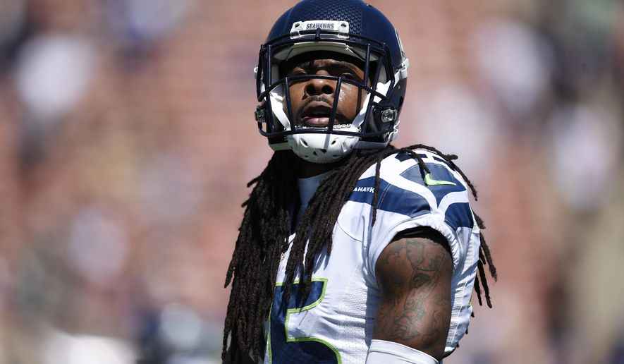 In this Sunday, Sept. 18, 2016, photo, Seattle Seahawks cornerback Richard Sherman (25) warms up prior to an NFL football game against the Los Angeles Rams at the Los Angeles Memorial Coliseum in Los Angeles. Sherman said Wednesday the public isn't listening to the message NFL players are trying to send with their actions during the national anthem. (AP Photo/Kelvin Kuo)