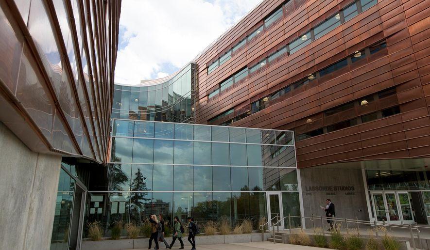 People walk around the new Lassonde Studios at the University of Utah in Salt Lake City on Thursday, Sept. 22, 2016. (Spenser Heaps/The Deseret News via AP)