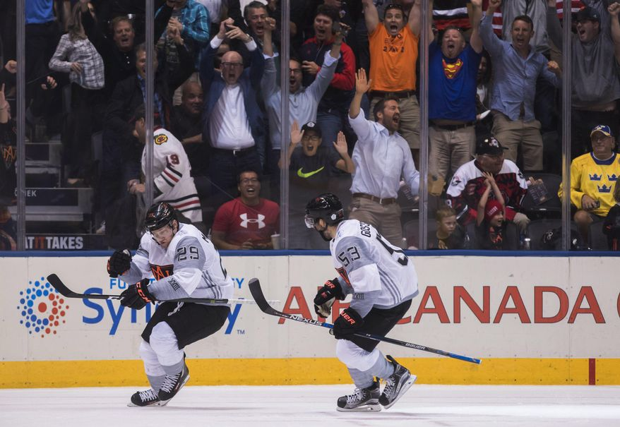Team North America's Nathan MacKinnon, left, celebrates his game winning goal with teammate Shayne Gostisbehere against Sweden during overtime of a World Cup of Hockey game in Toronto on Wednesday, Sept. 21, 2016. (Mark Blinch/The Canadian Press via AP)