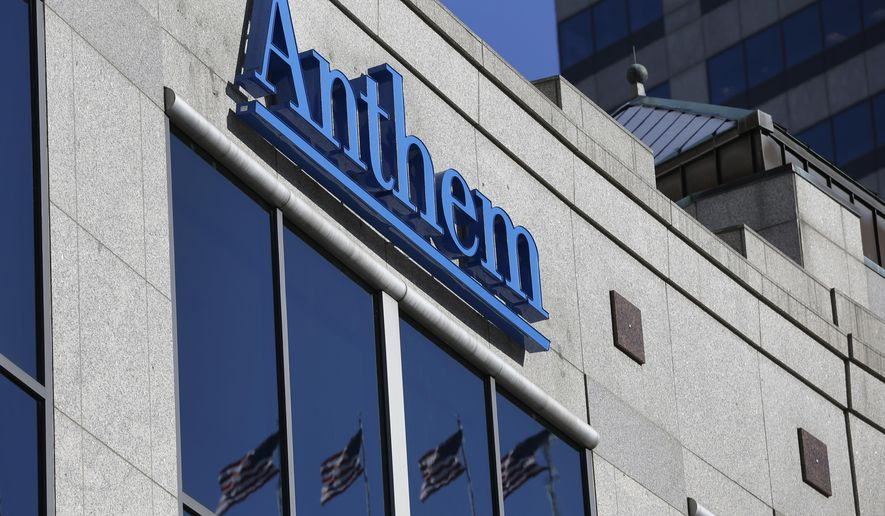 FILE - In this Thursday, Feb. 5, 2015, file photo, the Anthem logo hangs at the health insurer's corporate headquarters in Indianapolis. The Yahoo hack, reported on Thursday, Sept. 22, 2016, exposed personal details from at least 500 million user accounts, potentially the largest breach of an email provider in history. In early 2014, the health insurer Anthem disclosed that hackers had stolen information on almost 80 million current and former customers and employees. (AP Photo/Michael Conroy, File)