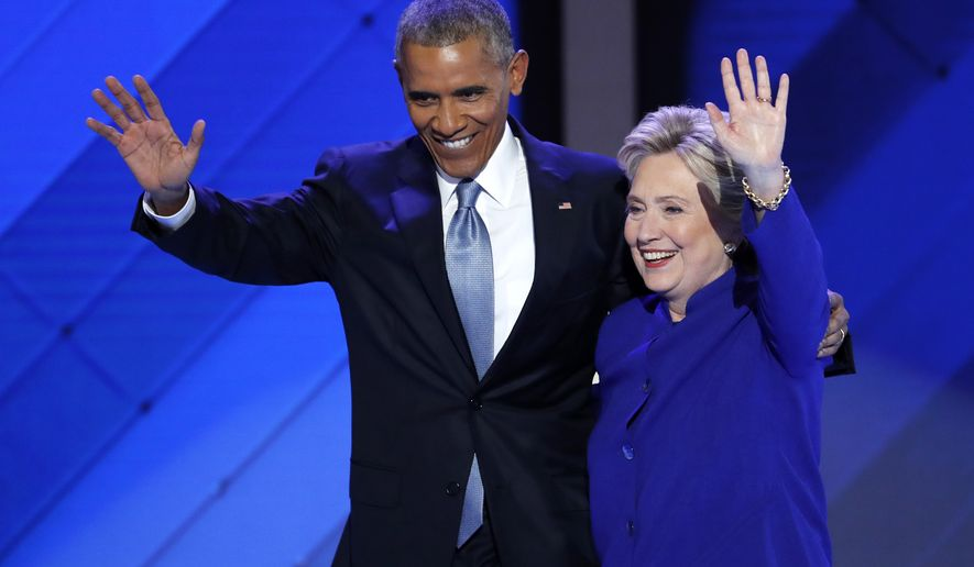 FILE - In this July 27, 2016 file photo, President Barack Obama and Democratic presidential nominee Hillary Clinton wave to delegates after President Obama's speech during the third day of the Democratic National Convention in Philadelphia. Hillary Clinton long planned to activate the much-vaunted Obama coalition to carry her to the White House. But a rough month on the trail has exposed a big challenge, the Obama coalition belongs to Barack Obama.  (AP Photo/J. Scott Applewhite, File)
