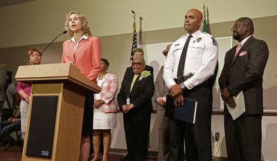 Charlotte mayor Jennifer Roberts, left, speaks in Charlotte, N.C. Friday, Sept. 23, 2016 as Charlotte-Mecklenburg Police chief Kerr Putney, right, listens during a news conference concerning protests and the investigation into Tuesday's fatal police shooting of Keith Lamont Scott.  A third night of protests over the fatal police shooting in Charlotte gave way to quiet streets as a curfew enacted by the city's mayor ended early Friday.  (AP Photo/Chuck Burton)