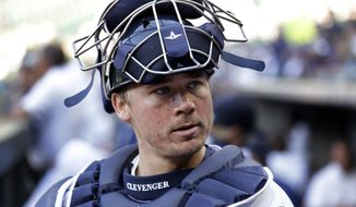 A June 29, 2016, file photo, Seattle Mariners catcher Steve Clevenger looks out of the dugout before a baseball game against the Pittsburgh Pirates in Seattle. Clevenger was suspended for the rest of the season without pay Friday, Sept. 23, 2016, by the Mariners in the wake of his tweets regarding a recent police shooting in Charlotte, N.C., and the Black Lives Matter movement.  (AP Photo/Elaine Thompson, File)