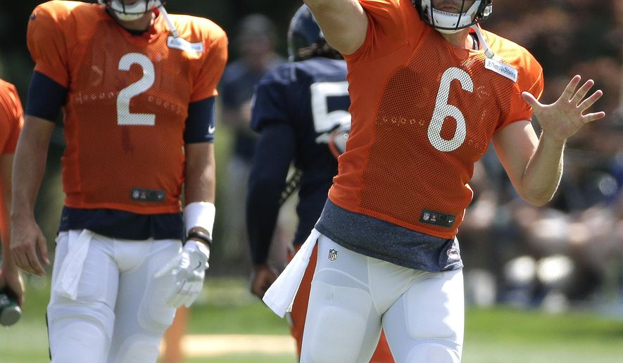FILE - In this Aug. 15, 2016, file photo, Chicago Bears quarterback Jay Cutler (6) throws the ball as quarterback Brian Hoyer (2) looks on during an NFL football training camp practice with the New England Patriots in Foxborough, Mass.  If Cutler is sidelined Sunday night with a sprained right thumb that forced him out during last week's 29-14 loss to Philadelphia, Brian Hoyer is in line for his 27th career start with his fourth different team _ and his first against the Cowboys. (AP Photo/Steven Senne, File)