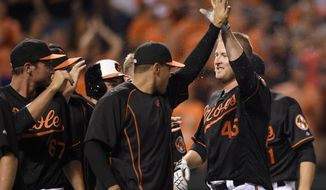 Baltimore Orioles' Mark Trumbo (45) celebrates with teammates after he hit a walkoff home run during the 12th inning of a baseball game against the Arizona Diamondbacks, Friday, Sept. 23, 2016, in Baltimore. (AP Photo/Nick Wass)