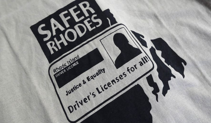 A t-shirt highlighting drivers licenses for all is displayed on a table during a community meeting at the Olneyville Neighborhood Association, Tuesday, Sept. 20, 2016, in Providence, Rhode Island. Immigrant activists are planning a church-to-church march through a cluster of Rhode Island cities in response to years of political inaction on bills to grant driver's licenses to people in the country illegally. (AP Photo/Charles Krupa)