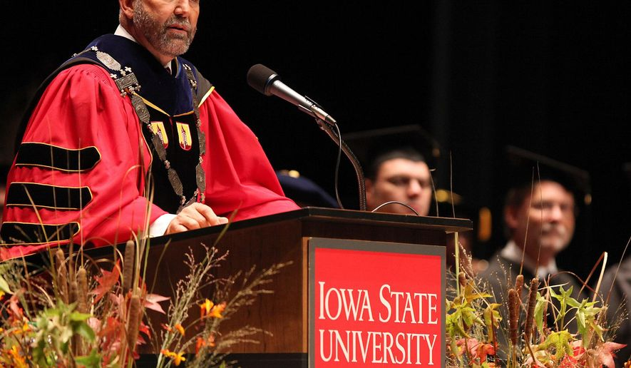 """FILE - In this Sept. 14, 2012 file photo, Iowa State President Steven Leath speaks he is officially installed as the university's 15th president during a ceremony in Ames, Iowa. Leath caused """"substantial damage"""" to a university airplane he was piloting when it made a hard landing at an Illinois airport last year - a costly incident kept quiet for 14 months. Reports obtained by The Associated Press show both wings suffered damage after Leath failed to navigate windy conditions and hit the runway at the Central Illinois Regional Airport in Bloomington, Ill. The university confirmed the incident Friday, Sept. 23, 2016, after AP inquiries, saying it paid for $12,000 in repairs itself rather than file an insurance claim. (Bryon Houlgrave/The Des Moines Register via AP, File)"""