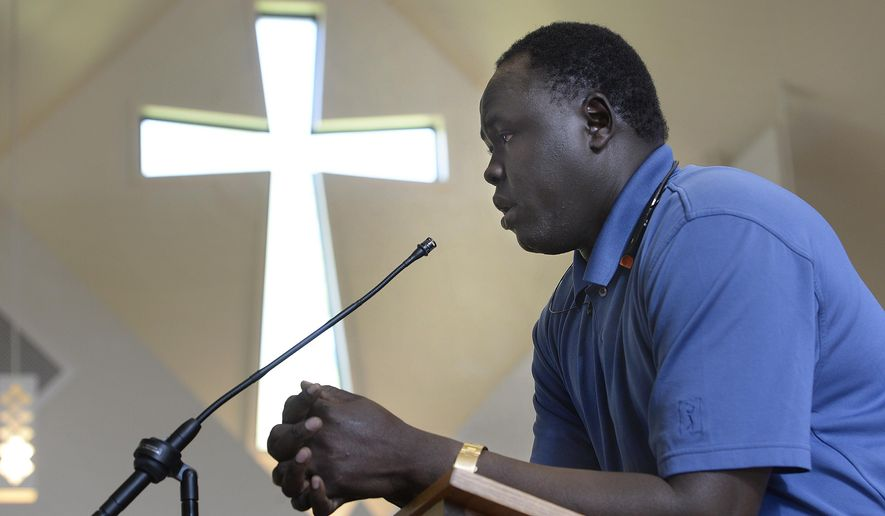 Atem Alue speaks during the memorial service for 36-year-old Philip Aguto at All Saints Episcopal Church in Salt Lake City, Sunday, Aug. 28, 2016. Aguto was killed in a hit-and-run accident. in mid-August. He and Alue were both part of the 20,000 Lost Boys of Sudan, and came to the U.S. in 2001. (Scott Sommerdorf /The Salt Lake Tribune via AP)