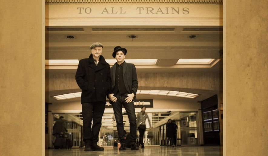 "This CD cover image released by Cooking Vinyl, ""Shine A Light: Field Recordings from the Great American Railroad,"" by Billy Bragg and Joe Henry. (Cooking Vinyl via AP)"