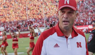 FILE - In this Sept. 17, 2016, file photo, Nebraska head coach Mike Riley is overcome by emotion following the 35-32 win over Oregon in an NCAA college football game in Lincoln, Neb. The Cornhuskers open Big Ten play at Northwestern on Saturday, Sept. 24, looking to build on a big win that vaulted them into the Associated Press poll for the first time in nearly two years. (AP Photo/Nati Harnik, File)