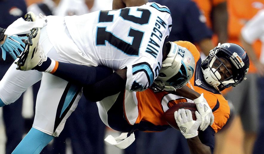 FILE - In this Sept. 8, 2016, file photo, Denver Broncos wide receiver Emmanuel Sanders (10) is hit by Carolina Panthers defensive back Robert McClain (27) during the first half of an NFL football game in Denver. Sanders, who signed a three-year, $33 million extension with the Broncos on the eve of this season's opener, has gained a reputation as a fearless receiver who can take a licking and keep on ticking. (AP Photo/Joe Mahoney, File)
