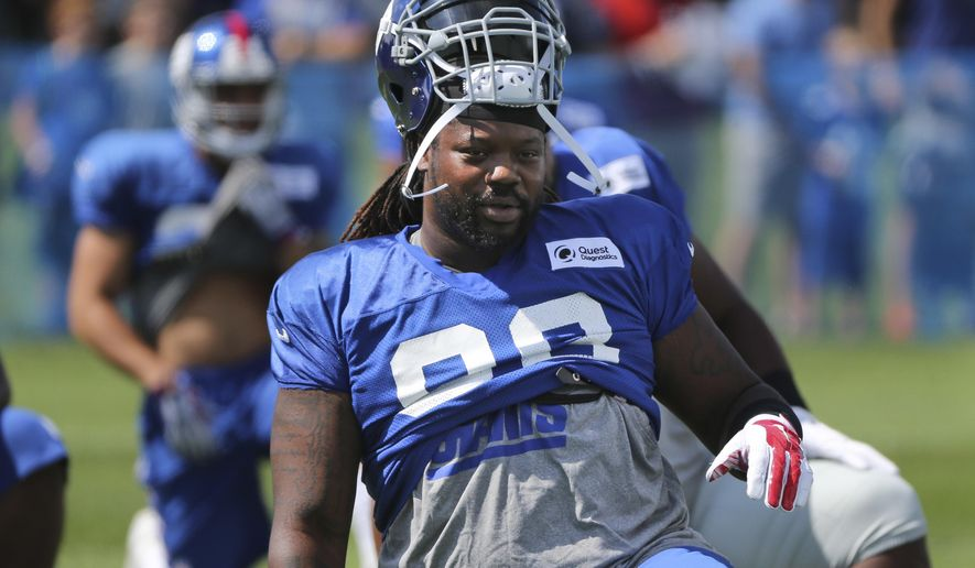 FILE - In this Aug. 2, 2016, file photo, New York Giants' Damon Harrison stretches during practice at the team's NFL football training camp in East Rutherford, N.J. The Giants spent a lot of money to sign Olivier Vernon and Damon Harrison and to re-sign Jason Pierre-Paul for the defensive line. Through two games, New York has two sacks, one by safety Landon Collins and the other from nickel back Leon Hall. Still, the Giants are off to their best start since 2009, and host the Redskins on Sunday. (AP Photo/Seth Wenig, File)