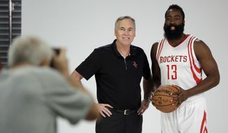 Houston Rockets' James Harden, right, poses with coach Mike D'Antoni during NBA basketball media day Friday, Sept. 23, 2016, in Houston. (AP Photo/David J. Phillip)