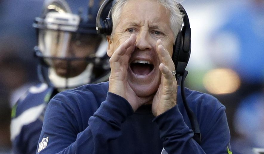 FILE - In this Sept. 11, 2016, file photo, Seattle Seahawks head coach Pete Carroll yells to his team during the second half of an NFL football game against the Miami Dolphins in Seattle. No team in the NFL has faced more punishment from the league for violations of offseason workout parameters than the Seattle Seahawks. That's not a list the Seahawks want to lead, but they are now bordering on serious penalties for another infraction. (AP Photo/Elaine Thompson, File)