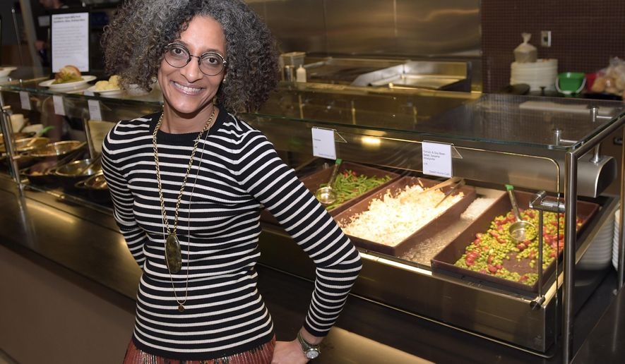 FILE - In this Sept. 14, 2016 file photo, Carla Hall, the Chew co-host and Top Chef alum, poses for a photo inside the North Star Cafe at the National Museum of African American History and Culture in Washington. The museum, opening later this month, will be an experience aimed at feeding the soul, literally. The Sweet Home Cafe is the museum's restaurant, with a menu featuring culturally authentic fare and modern-day-inspired foods. The restaurant is a journey through the agricultural south, Creole coast, northern states and the Southwest.  (AP Photo/Susan Walsh, File)