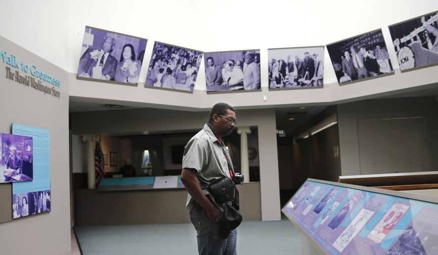 Charles Boyles looks at the exhibition at the DuSable Museum of African American History Thursday, Sept. 22, 2016, in Chicago. The dedication of the Smithsonian Institution's National Museum of African American History and Culture will be celebrated on Saturday in Washington and on Chicago's south side at one of the oldest museums of its kind. (AP Photo/Tae-Gyun Kim)
