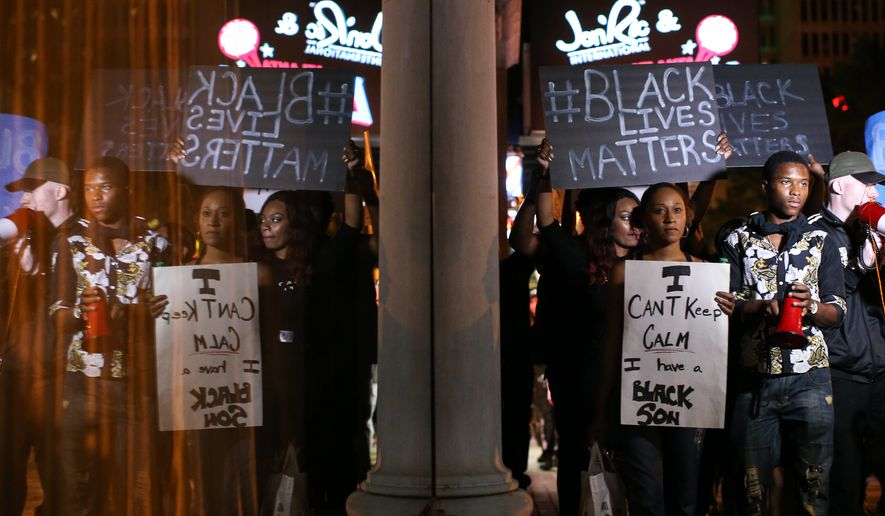 Black Lives Matter protesters march in downtown Atlanta, Saturday, Sept. 24, 2016, in response to the police shooting deaths of Terence Crutcher in Tulsa, Okla., and Keith Lamont Scott in Charlotte, N.C. (AP Photo/Branden Camp)