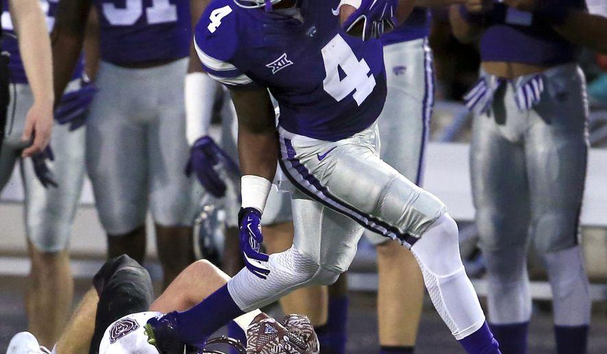 Kansas State kick returner Dominique Heath (4) runs over Missouri State's Nick Masoner (39) during the first half of an NCAA college football game in Manhattan, Kan., Saturday, Sept. 24, 2016. (AP Photo/Orlin Wagner)