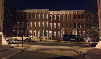 Police investigate the scene of a multiple shooting in Baltimore on Saturday, Sept. 24, 2016. A police spokesperson said none of the injuries are life threatening. (AP Photo/Juliet Linderman)