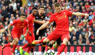 Liverpool's James Milner scores his team's fifth goal of the game from the penalty spot during the English Premier League soccer match between Liverpool and Hull City at Anfield Stadium in Liverpool, England, Saturday, Sept, 24, 2016. (Dave Howarth/PA via AP)