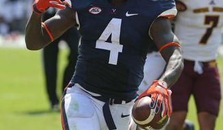 Virginia running back Taquan Mizzell (4) celebrates a touchdown run during an NCAA college football game in Charlottesville, Va., Saturday, Sept. 24, 2016. Virginia won 49-35. (Andrew Shurtleff/The Daily Progress via AP)