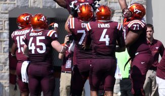 Virginia Tech wide receiver Cam Phillips (5) celebrates a touchdown catch with his teammates during the second quarter of an NCAA college football game against East Carolina in Backsburg, Va., Saturday, Sept. 24 2016. (Matt Gentry/The Roanoke Times via AP)