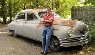 ADVANCE FOR RELEASE SATURDAY, SEPTEMBER 24, 2016, AT 12:01 A.M. CDT. AND THEREAFTER - In this Sept. 16, 2016 photo, Steve Rall poses with his first car, a 1949 Packard Deluxe Eight, at his home in east Lincoln, Neb. He's always been hooked on obscure automobiles, but he wouldn't have thought twice about buying the Packard if not for memories of owning the car as a teen. (Matt Ryerson/The Journal-Star via AP)