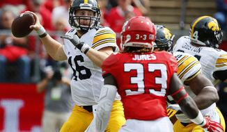 Iowa quarterback C.J. Beathard (16) attempts to pass against Rutgers during the first half of an NCAA college football game in Piscataway, N.J., Saturday, Sept. 24, 2016. (AP Photo/Noah K. Murray)