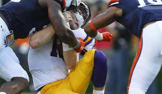 LSU quarterback Danny Etling (16) is tackled by Auburn linebacker Tre' Williams (30) during the first half of an NCAA college football game, Saturday, Sept. 24, 2016, in Auburn, Ala. Williams was ejected for targeting. (AP Photo/Butch Dill)