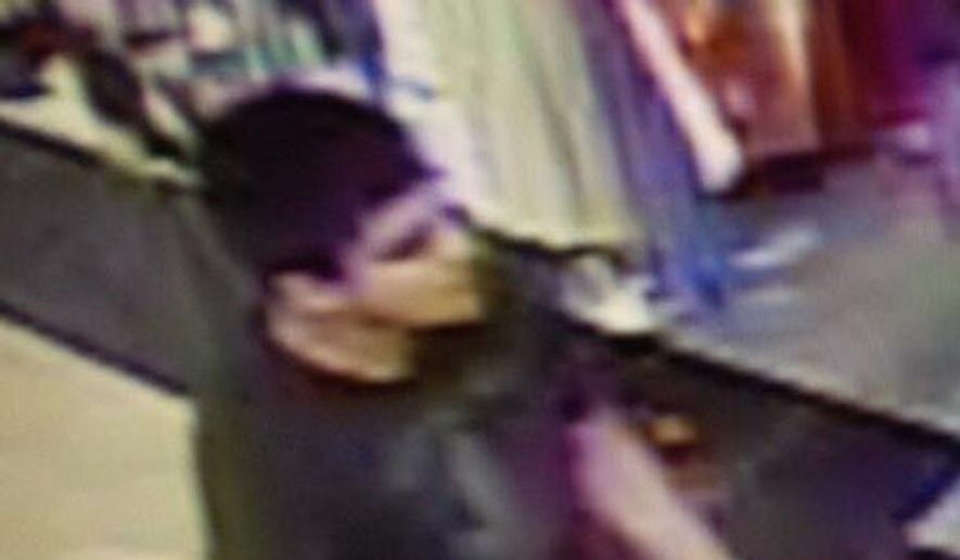 This video image provided by Skagit County Department of Emergency Management shows a suspect wanted by the authorities regarding a shooting at the Cascade Mall in Burlington, Wash., Friday, Sept. 23, 2016. Authorities in Washington State say several people have been killed during a shooting at a mall north of Seattle and that at least one suspect remains at large. (Skagit County Department of Emergency Management via AP)
