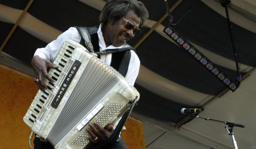 """FILE - In this May 5, 2007 file photo, Buckwheat Zydeco performs during the 2007 Jazz and Heritage Festival in New Orleans.   Stanley """"Buckwheat"""" Dural Jr., who introduced zydeco music to the world through his namesake band Buckwheat Zydeco, has died. He was 68. His longtime manager Ted Fox told The Associated Press that Dural died early Saturday, Sept. 24, 2016. He had suffered from lung cancer.(AP Photo/Dave Martin)"""